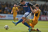 George Donnelly of Rochdale shoots at goal under pressure from Kevin Feely of Newport. Skybet football league two match, Newport county v Rochdale at Rodney Parade in Newport, South Wales on Saturday 3rd May 2014.<br /> pic by Mark Hawkins, Andrew Orchard sports photography.