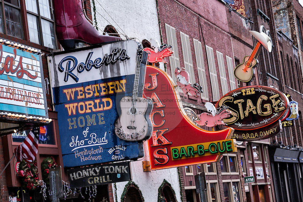 Signs for Roberts Western World, Jacks Bar-B-Que and other honky-tonks on lower Broadway in Nashville, TN.