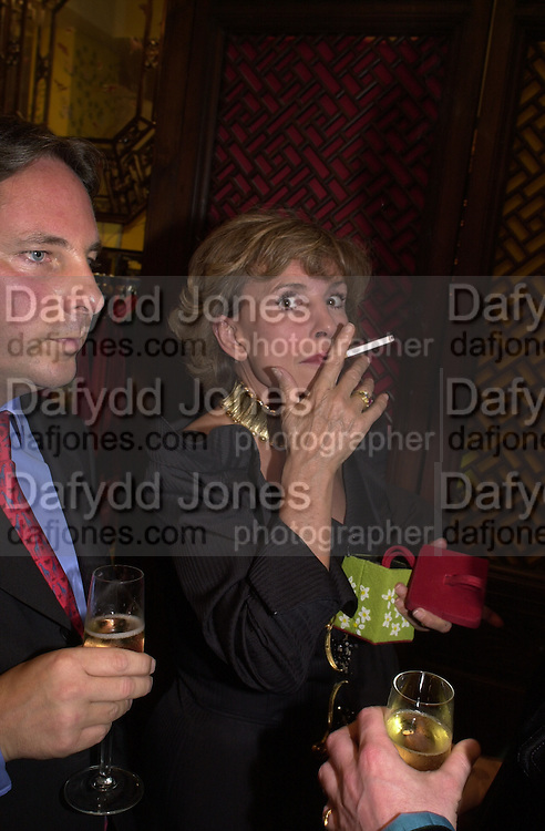 Piers Birtwistle and Lady Powell. Shanghai Tang opening. Sloane St. 11 April 2001. © Copyright Photograph by Dafydd Jones 66 Stockwell Park Rd. London SW9 0DA Tel 020 7733 0108 www.dafjones.com