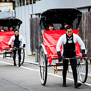 Guides pull tourists in rickshaws in Kyoto, Japan.