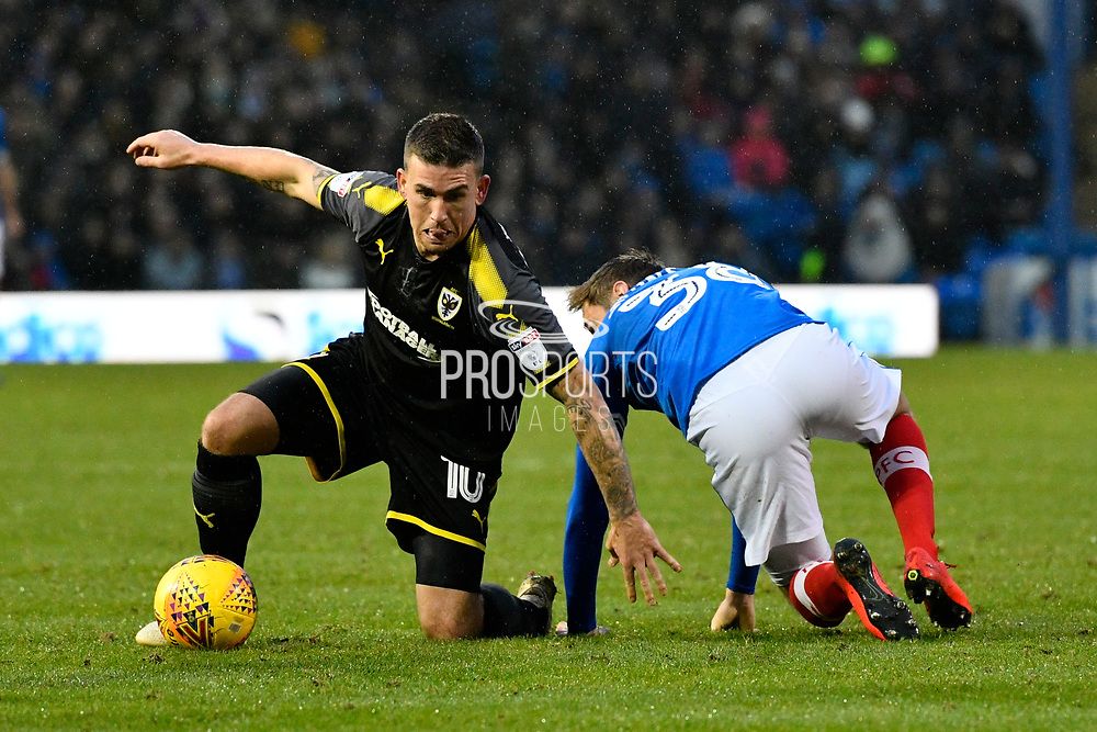 Cody McDonald (10) of AFC Wimbledon gets back to his feet after being challenged by Brandon Haunstrup (38) of Portsmouth during the EFL Sky Bet League 1 match between Portsmouth and AFC Wimbledon at Fratton Park, Portsmouth, England on 26 December 2017. Photo by Graham Hunt.