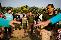Recent arrivals of drug abusers line up for exercise at Orkas Khnom, or My Chance, a government-run facility where youth and young men are brought here by their families or by arrest from police to be re-educated from drug addiction, just outside Phnom Penh, Cambodia, on Tuesday, May 11, 2010.