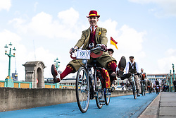 © Licensed to London News Pictures. 04/05/2019. London, UK. A man holds his legs in the air as he cycles across Southwark Bridge on the Tweed Run bike ride in Central London. The annual event sees hundreds of people cycle around the capital past various landmarks wearing vintage tweed outfits. Photo credit: Rob Pinney/LNP