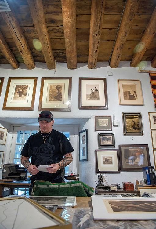em072017c/jnorth/Zac Cox, grandson of the owners of The Rainbow Man on Palace Avenue, stands in one of the older rooms of the gallery in Santa Fe, Thursday July 20, 2017. Historians have been dating vigas and other materians in the old buildings along Palace. (Eddie Moore/Albuquerque Journal)