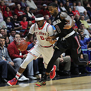 Durand Johnson, (left), St. John's, drives past Sindarius Thornwell, South Carolina, during the St. John's vs South Carolina Men's College Basketball game in the Hall of Fame Shootout Tournament at Mohegan Sun Arena, Uncasville, Connecticut, USA. 22nd December 2015. Photo Tim Clayton