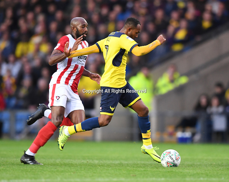 August 8th 2017, Kassam Stadium, Oxford, England; Carabao Cup First Round; Oxford United versus Cheltenham; Robert Hall of Oxford United gets past Nigel Atangana of Cheltenham