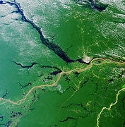 Convergence of the Rio Solimoes and the Rio Negro close to Manaus, Brazil, to form the River Amazon River, the greatest river on Earth. Satellite image 23 July 2000.    Credit: NASA. Geography