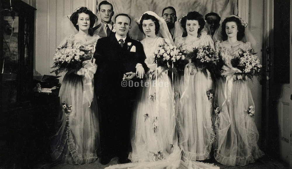group photograph of groom and brides