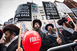 "London, July 5th 2014. Jews from the Naturei Karta demonstrate with hundreds protesting near the Israeli embassy in London against the ongoing occupation of Palestine and the west's support of ""Israel's collective punishment of Palestinians""."