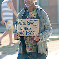 "Actor/extra David Cardenas, 64, carries a sign that reads, ""Will Run Lines for food"" during a filming of an episode of Showtime's hit TV show, 'Californication' at Ocean Front Walk in Santa Monica on Monday, July 11, 2011."