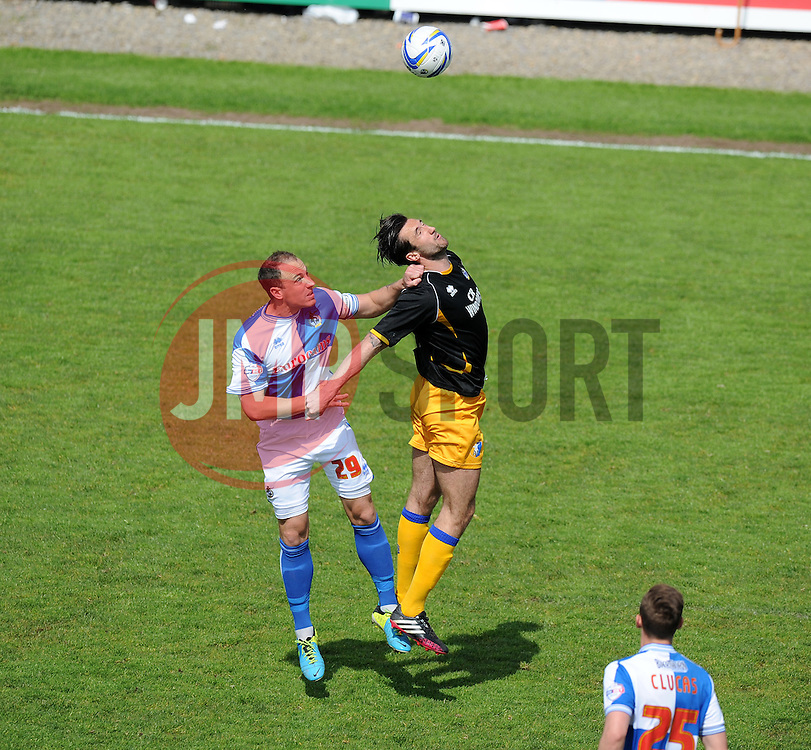 Bristol Rovers' Ryan Brunt battles for a high ball with Mansfield Town's Ollie Palmer - Photo mandatory by-line: Alex James/JMP - Mobile: 07966 386802 03/05/2014 - SPORT - FOOTBALL - Bristol - Memorial Stadium - Bristol Rovers v Mansfield - Sky Bet League Two