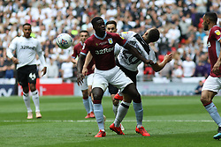 May 27, 2019 - London, England, United Kingdom - Axel Tuanzebe (4) of Aston Villa battles with Mason Bennett (20) of Derby County during the Sky Bet Championship Play Off Final between Aston Villa and Derby County at Wembley Stadium, London on Monday 27th May 2019. (Credit Image: © Mi News/NurPhoto via ZUMA Press)