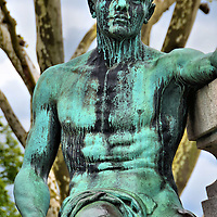 Monument of Remembrance Grieving Soldier in Luxembourg City, Luxembourg <br /> Approximately four to six million allied military personnel died during WWI.  This bronze statue by Claus Cito is a magnificent portrayal of a grieving soldier as he sits in anguish beside a fallen comrade (off camera).  Both are at the base of the Monument of Remembrance in Luxembourg City.