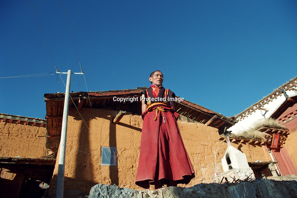 "ZHONGDIAN COUNTY, DECEMBER 19, 2000: a Tibetan monk stands in Songzanlin monastery, Yunnan province , December 19, 2000..Zhongdian county is believed to be part of the areas on which James Hilton's famous novel "" lost Horizon""- a description of Shangri-La- is modelled.. ."