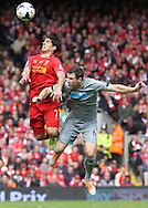 Luis Suarez of Liverpool and Michael Williamson of Newcastle United in action during the Barclays Premier League match at Anfield, Liverpool.<br /> Picture by Michael Sedgwick/Focus Images Ltd +44 7900 363072<br /> 11/05/2014