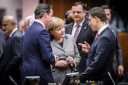 Angela Merkel, Germany's chancellor, center, speaks with Mari Kiviniemi, Finland's prime minister, right, and David Cameron, the U.K.'s prime minister, left, during the first day of the EU Summit, at the European Council headquarters in Brussels, Belgium on Thursday, Dec. 13, 2012. (Photo © Jock Fistick)