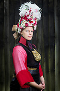 Ann-Cathrin is wearing a traditional Vierl&auml;nder Bridal Costume in Neuengamme in Hamburg, Germany on June 25, 2017.<br /> <br /> Vierlande was always known as the flower garden in Germany, an area that had many flower farmers. The bridal crown represent the flowers of the area.<br /> <br /> Men already abandoned the traditional clothing after the war after 1870. Women wore the traditional dresses until after WWI. During and after the war, women sold their dresses and costumes to women from the city of Hamburg who wore the dresses to the markets. Vierlande always stood for good quality, so people dressed up on the markets with Vierl&auml;nder Costumes to push the value of their products. Even the company Rama advertised their margarine products with a picture of a young women in traditional Vierl&auml;nder Costume in the beginning of 1900.