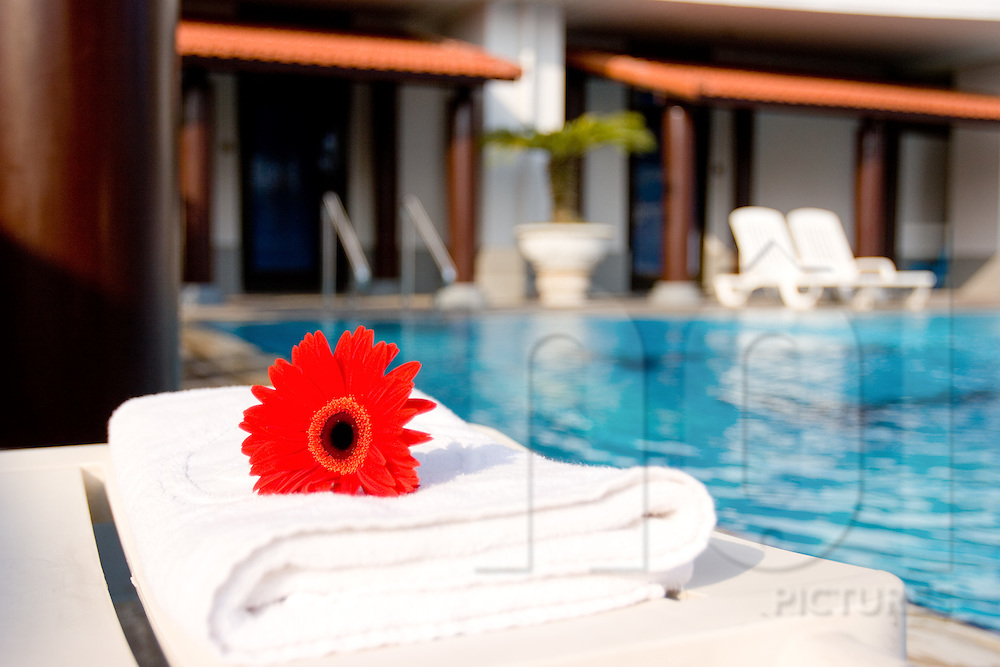 Fresh towels at a serviced apartment's private swimming pool, Vietnam, Southeast Asia