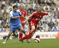 Photo: Aidan Ellis.<br /> Liverpool v Wigan Athletic. The Barclays Premiership. 21/04/2007.<br /> Liverpool's Dirk Kuyt and Wigan's Josip Skoko