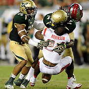 South Florida's Fidel Montgomery hits Rutgers' Mason Robinson knocking Robinson's helmet off and forcing a fumble as South Florida's Mark Joyce joins the play during the first half against Rutgers Thursday, Sept. 13, 2012.