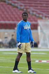 Oct 1, 2011; Stanford CA, USA;  UCLA Bruins linebacker Aramide Olaniyan (14) warms up before the game against the Stanford Cardinal at Stanford Stadium. Stanford defeated UCLA 45-19. Mandatory Credit: Jason O. Watson-US PRESSWIRE