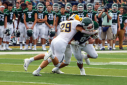 BLOOMINGTON, IL - September 28:  John Kappel wraps up Titan ball carrier Chrystian Maciorowski during a college football game between the IWU Titans and the Augustana Vikings on September 28 2019 at Wilder Field in Tucci Stadium in Bloomington, IL. (Photo by Alan Look)