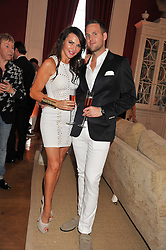 LIZZIE CUNDY and SCOTT HARVEY-NICHOLLS at a party to celebrate Tamara Ecclestone's 28th birthday held in Tyringham, Newport Pagnell, Bucks on15th June 2012.