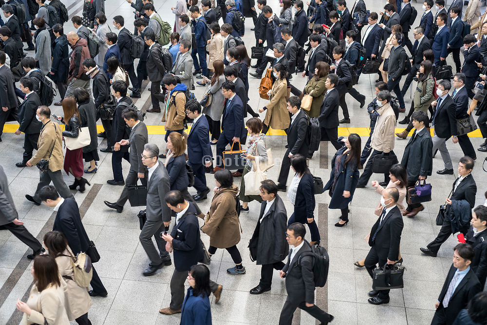 overhead view of commuting crowd in Tokyo Japan