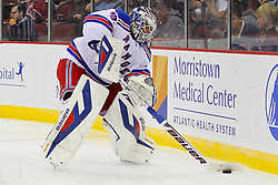 Sep 16, 2013; Newark, NJ, USA; New York Rangers goalie Henrik Lundqvist (30) passes the puck during the second period of their game against the New Jersey Devils at Prudential Center.