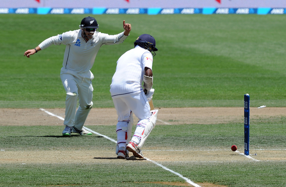 New Zealand's Tom Latham raises his finger as Sri Lanka's Rangara Herath is bowled out for 0 by Tim Southee on day three of the second International Cricket Test, Seddon Park, Hamilton, New Zealand, Sunday, December 20, 2015. Credit:SNPA / Ross Setford