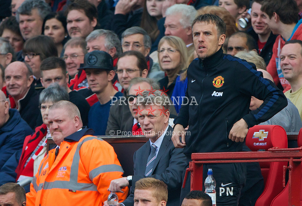 MANCHESTER, ENGLAND - Saturday, March 29, 2014: Manchester United's David Moyes and Phil Neville during the Premiership match against Aston Villa at Old Trafford. (Pic by David Rawcliffe/Propaganda)