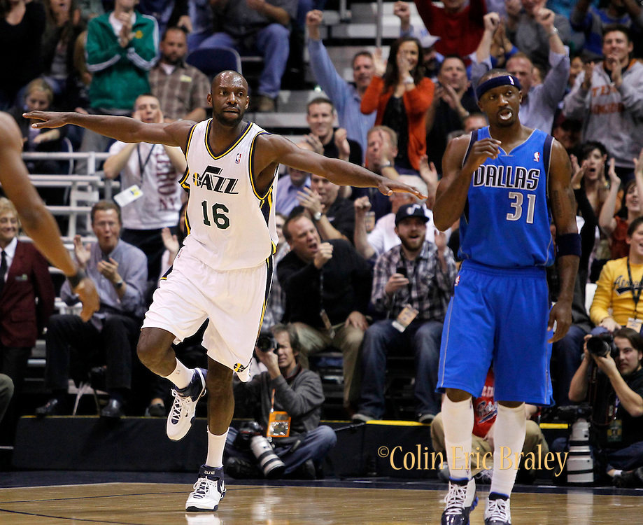 Utah Jazz center Francisco Elson (16) reacts after scoring as Dallas Mavericks shooting guard Jason Terry (31) walks to the bench following a called timeout during the first half of an NBA basketball game in Salt Lake City, Friday Dec. 3, 2010. (AP Photo/Colin E Braley)