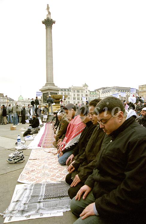 Muslims praying in Trafalgar Square London UK