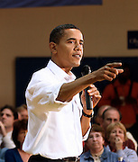 Senator Barack Obama (D-IL) responds to questions during an October 2007 town hall meeting in Newton, Iowa.