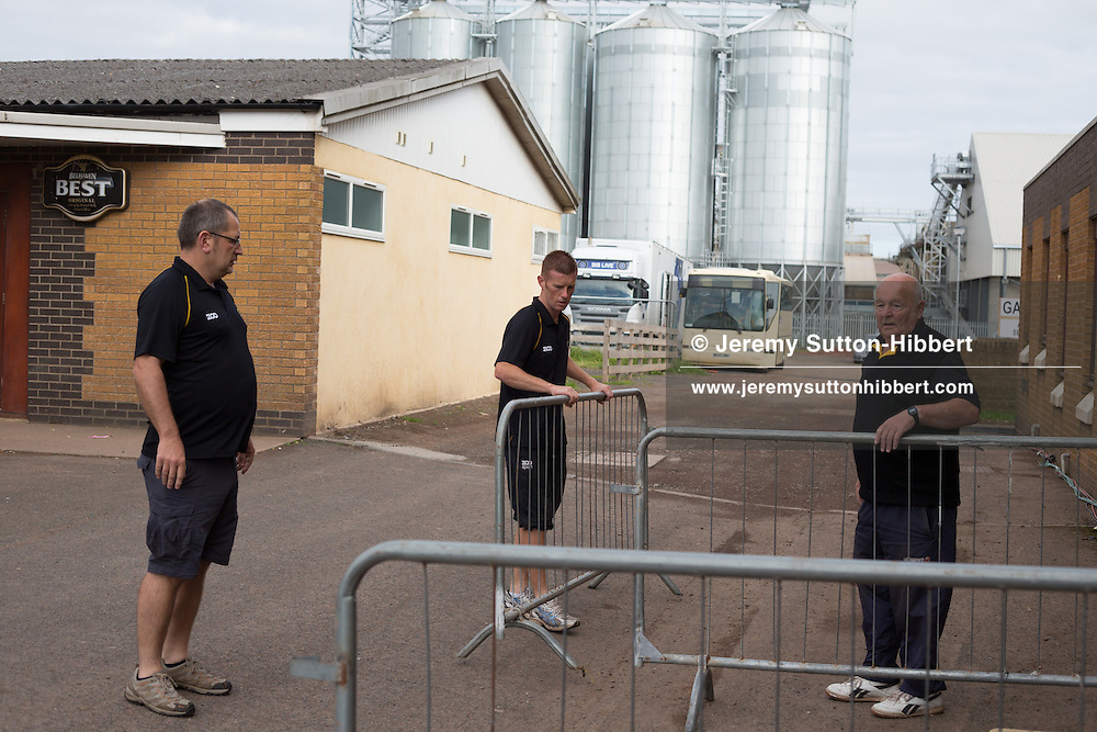 Security fencing is put in place outside the clubhouse, prior to the 3rd Division football game of Berwick Rangers versus Glasgow Rangers Football Club, at Shielfield Park, Berwick-Upon-Tweed, England, on Sunday 26th August 2012. .The final score was 1-1.
