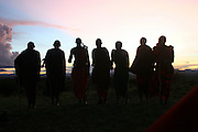 Africa, Tanzania, Silhouette of a group of Maasai men at sunset An ethnic group of semi-nomadic people February 2006