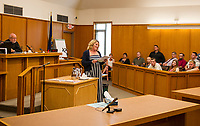 Julie Moulton thanks all who helped her through Recovery Court during the graduation ceremony held with Judge James Carroll at Belknap Country Superior Court on Tuesday afternoon.    (Karen Bobotas/for the Laconia Daily Sun)