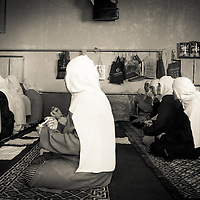 Imam Wang Shan Zhen with local devotees. <br /> A Chinese Female imams (priest) are part of the new scene of the Chinese opening. Wuzhong has the highest concentration of female imams in China. Over 20 of them lead prayers and advise women on religious affairs in this predominantly Muslim town.