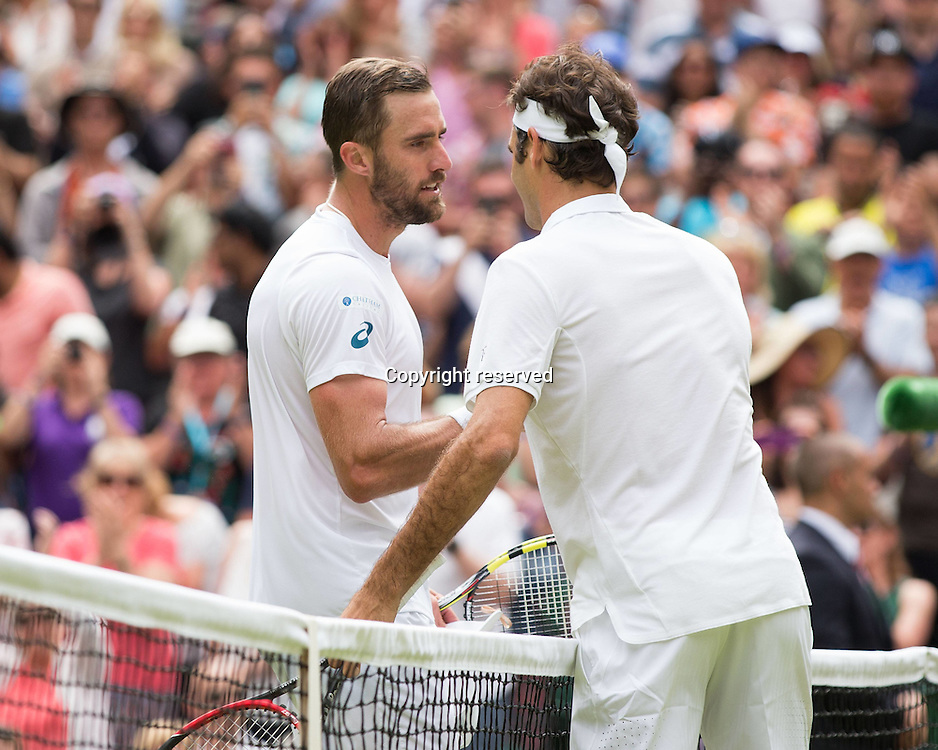 04.07.2016. All England Lawn Tennis and Croquet Club, London, England. The Wimbledon Tennis Championships Day 8.  Steve Johnson congratulates winner ROGER FEDERER (SUI)
