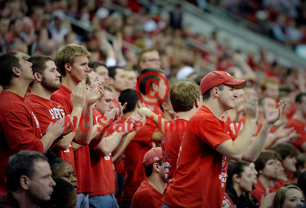 NCSU students cheer for the men's basketball team during a game against Boston College. Photo by Becky Kirkland.