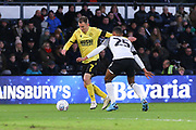 Millwall midfielder Jed Wallace (7) crosses the ball despite a challenge from Derby County defender Max Lowe (25) during the EFL Sky Bet Championship match between Derby County and Millwall at the Pride Park, Derby, England on 14 December 2019.