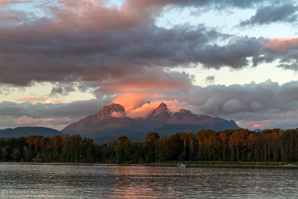 Mount Blandshard (The Golden Ears) and the Fraser River at sunset from Brae Island Regional Park in Langley, British Columbia, Canada