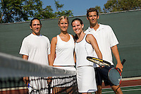 Mixed Doubles Tennis Players at Net