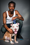Jacoby Palmer with his American Staffordshire terrier, Brownie, who is four months old.