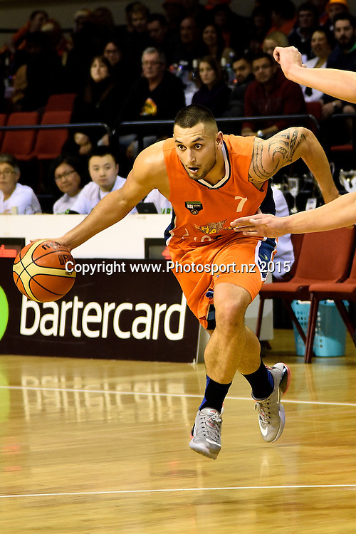 Duane Bailey (L) of the Southland Sharks dribbles the ball during the NBL semi final basketball match between Southland and Super City Rangers at the TSB Arena in Wellington on Saturday the 4th of July 2015. Copyright photo by Marty Melville / www.Photosport.nz