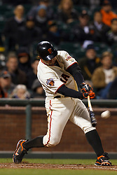 May 24, 2011; San Francisco, CA, USA;  San Francisco Giants right fielder Cody Ross (13) hits a double against the Florida Marlins during the ninth inning at AT&T Park. Florida defeated San Francisco 5-1.