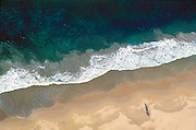 Catamaran on South Coast beach.<br /> Cover of island from Above.