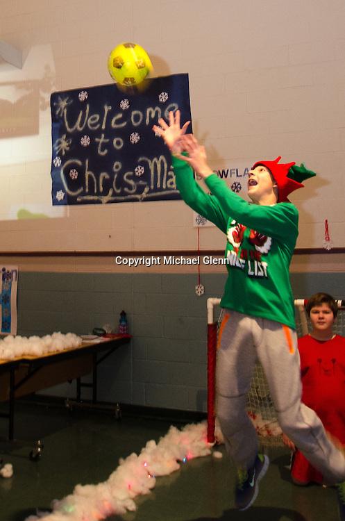 "19 Dec. 2013 Manahawkin USA // Students really get into the games at the All Saints Regional Catholic School ""Winter Wonderland"" Math exhibit"