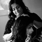 Ariel Zavala, bottom, does her makeup as her mother Monica works on her hair Saturday, April 30, 2016 in Tampa. Zavala who is transitioning from male to female attended her prom for Alonso High School on Saturday. CHRIS URSO/STAFF