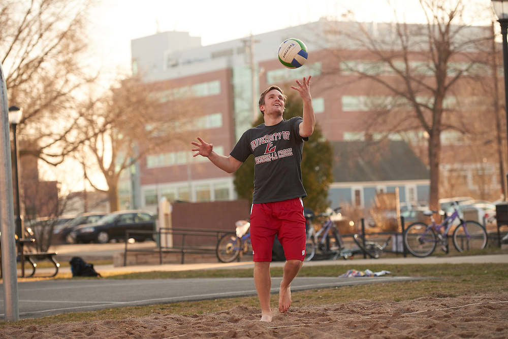 Activity; Playing; Relaxing; Socializing; Location; Outside; People; Student Students; UWL UW-L UW-La Crosse University of Wisconsin-La Crosse; Spring; March; Time/Weather; evening; Type of Photography; Candid; man volleyball eagle L; Campus Life